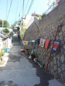 A shop located along the wall that sells organic souvenirs made by traditional material.